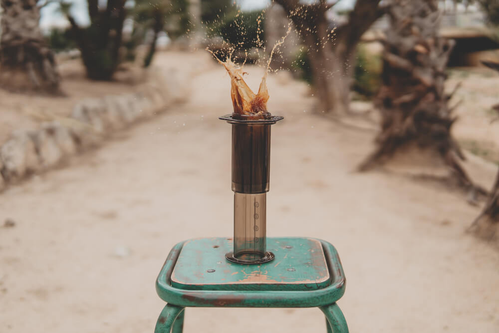 Aeropress-coffee-in-action-outside-dramatic
