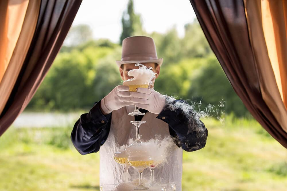 Bartender using dry ice for glamping event