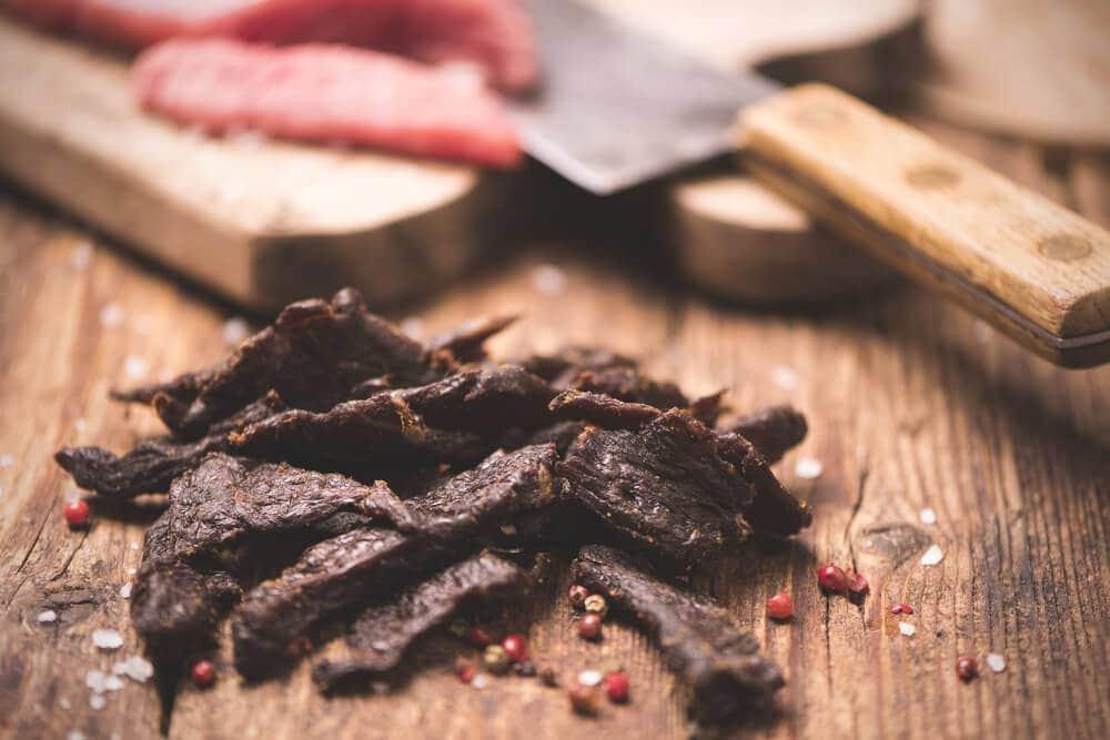 Beef jerky on wooden board