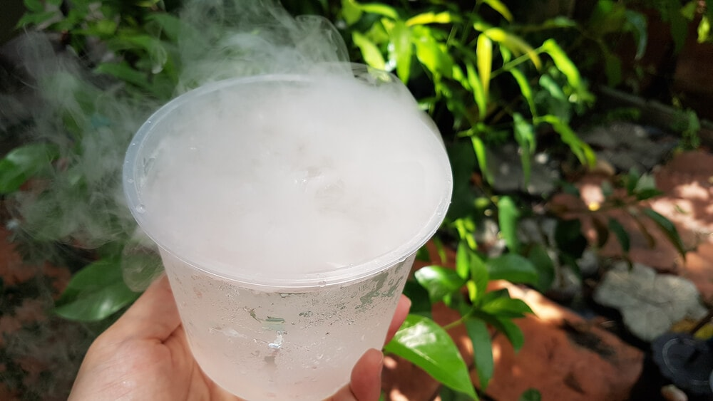 Beverage cooled outdoors using dry ice