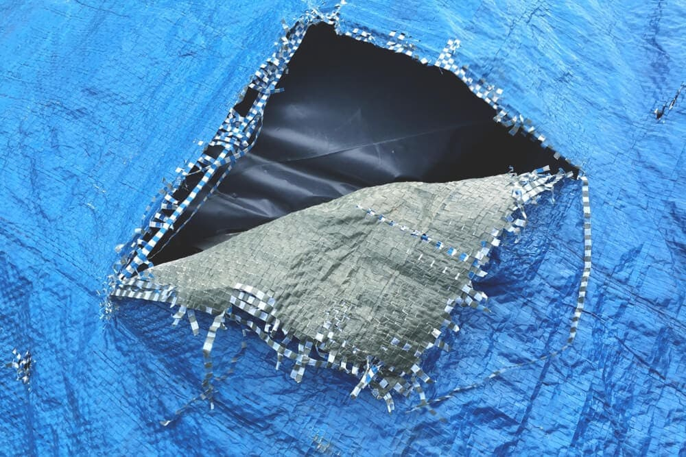 Blue tarp tear