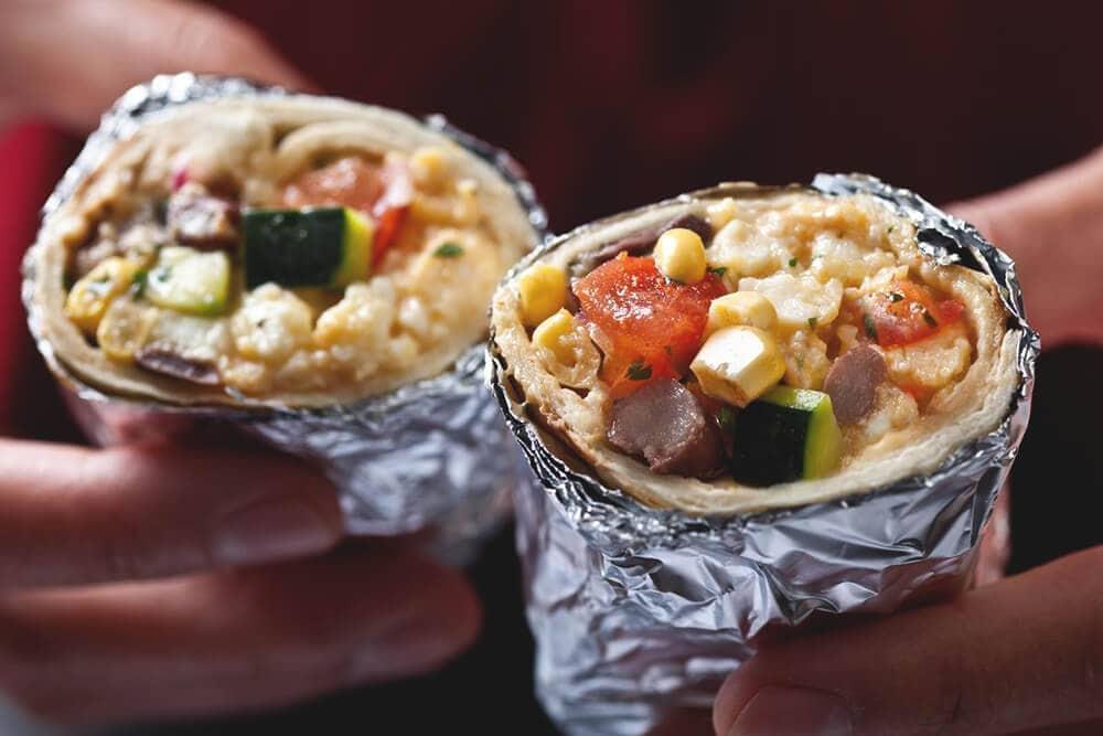 Breakfast burrito in foil campfire meals