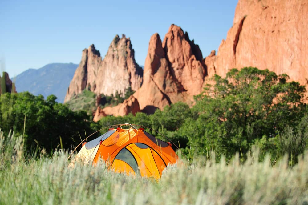 Bright clean orange tent with no mold erected in backcountry