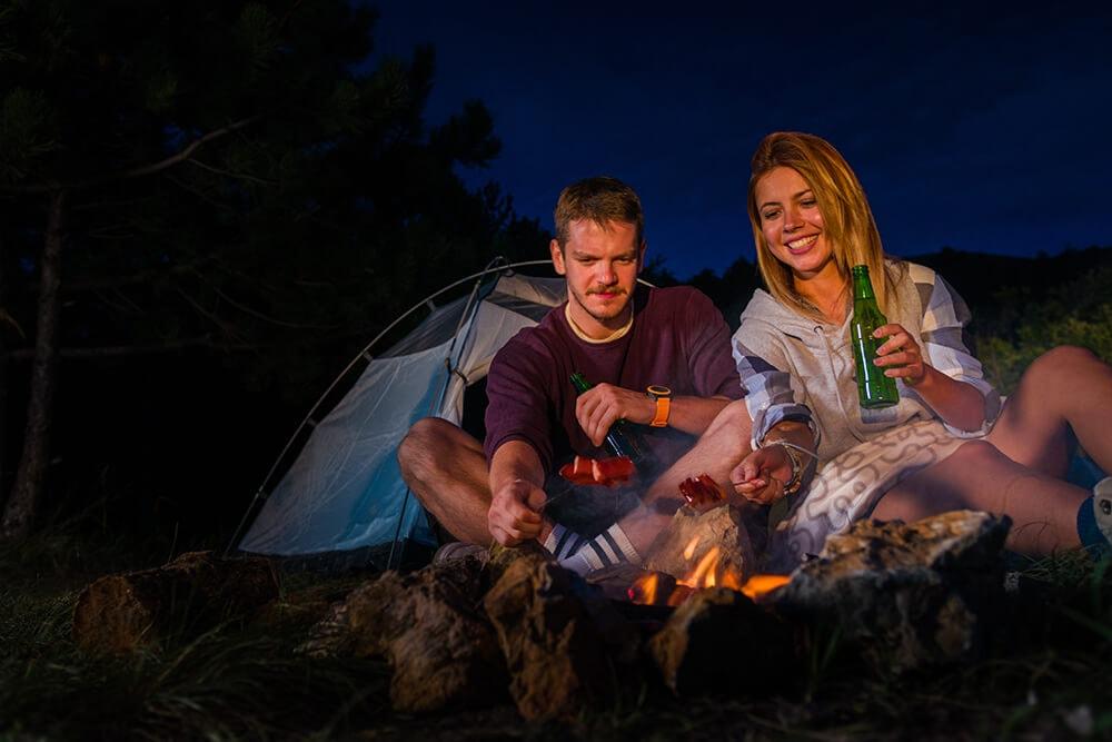 Campers having dinner after easy setup tent