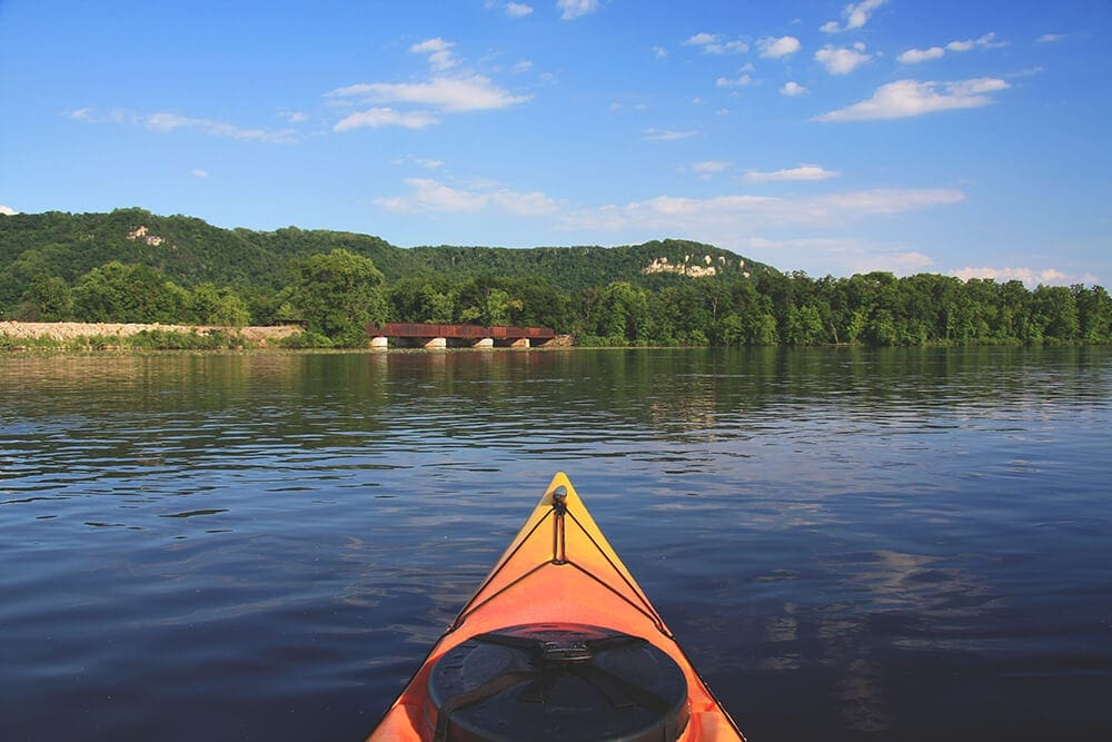 Canoe floating down the mississippi river featured image