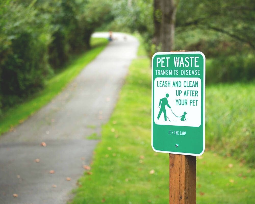 Clean-up-after-your-dog-green-sign-into-driveway