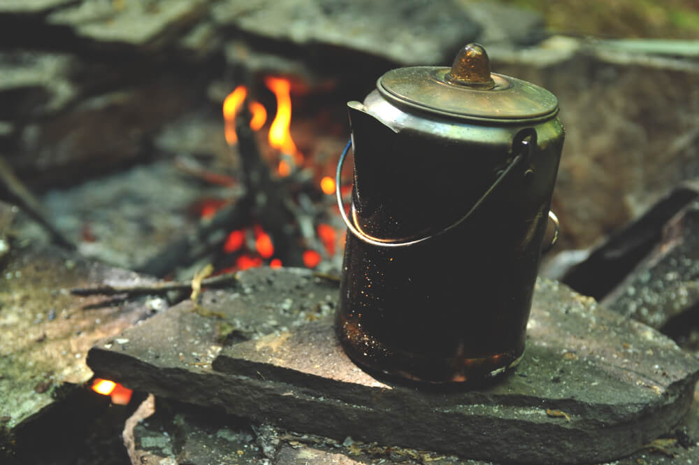 Cowboy-coffee-pot-cooling-down-after-hot-fire