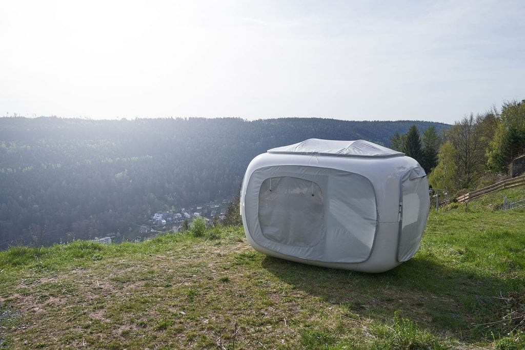 Grey Cube tent setup on lookout in backcountry