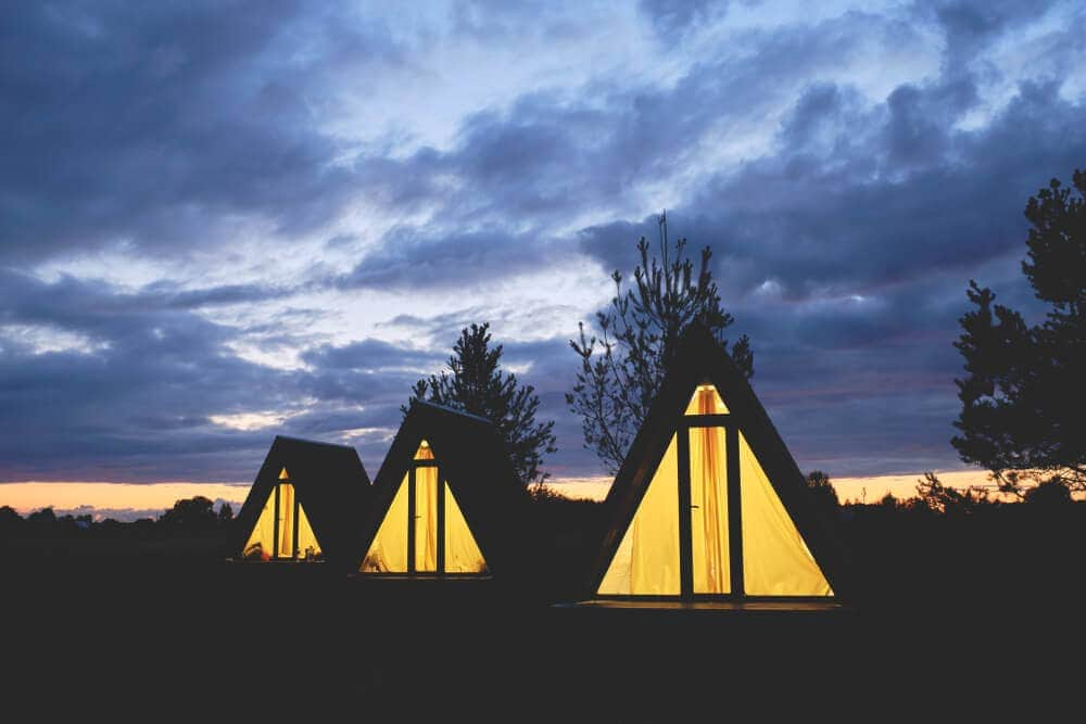 Glass and timber modern glamping tents