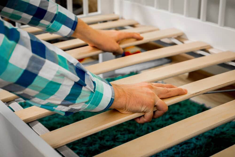 Handy person makeing single mattress from from timber