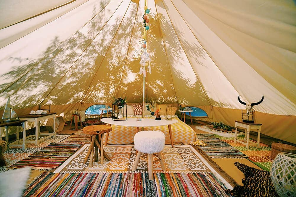 Inside a decorative glamping tent