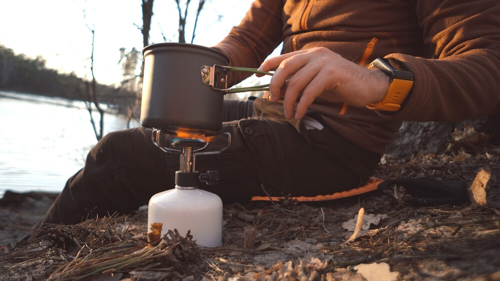 Lone camper heats cooking element or portable gas cylinder flame