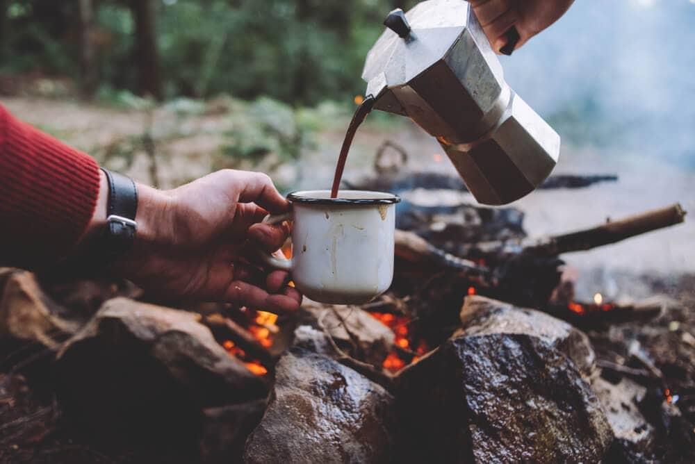 Moka-pot-pouring-hot-at-campfire