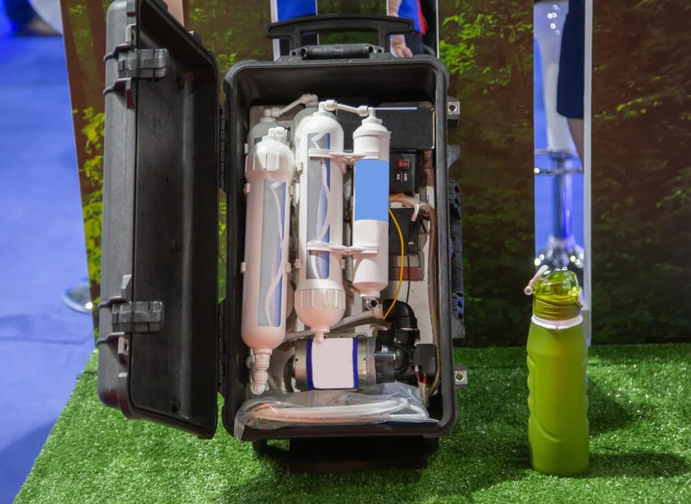 Open travel case with a multi chemical purification system of a camping water filter