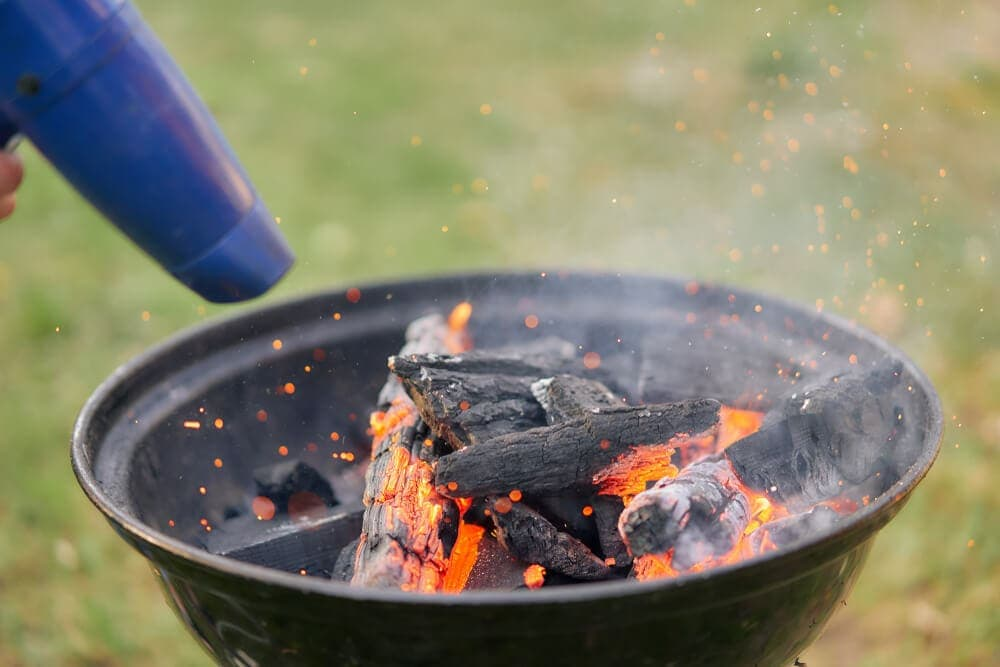 Outdoors cordless hair dryer igniting bbq fire coals