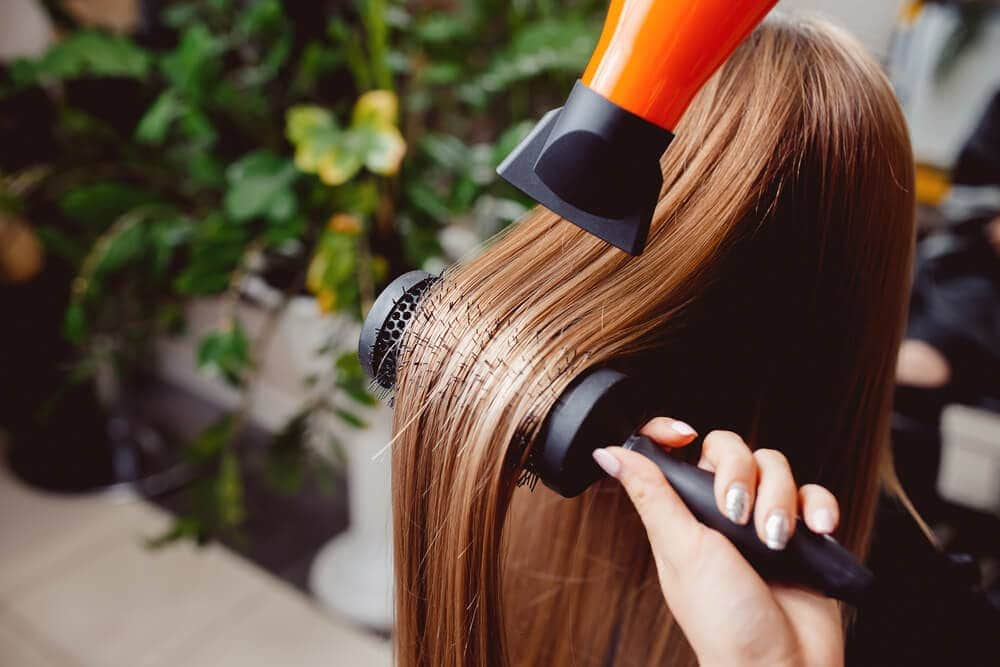 Portable cordless hair dyer used indoors and outdoors