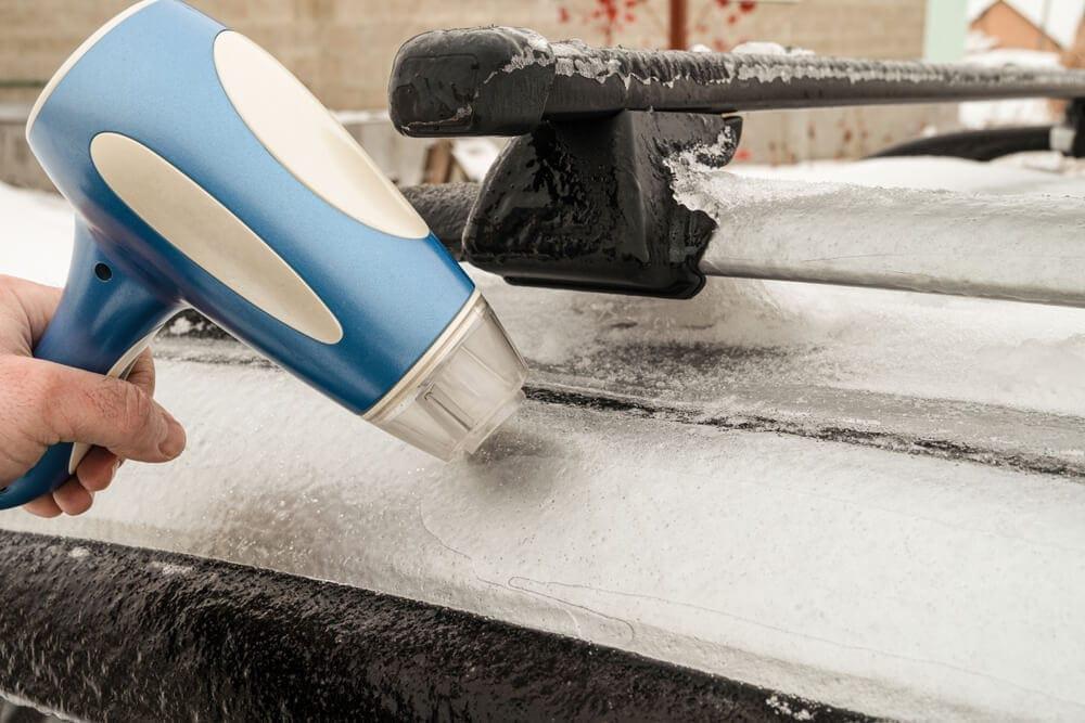 Portable hair dryer melting car ice outside