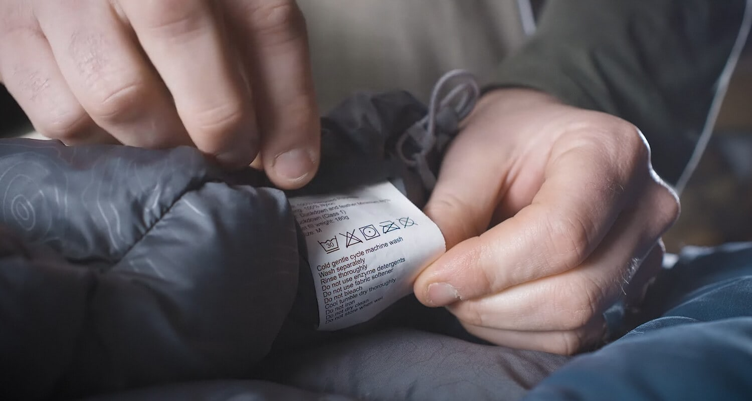 Read the down jacket care instructions label before washing