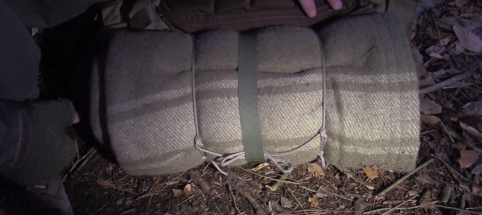 Sleeping blanket bag tied and rolled