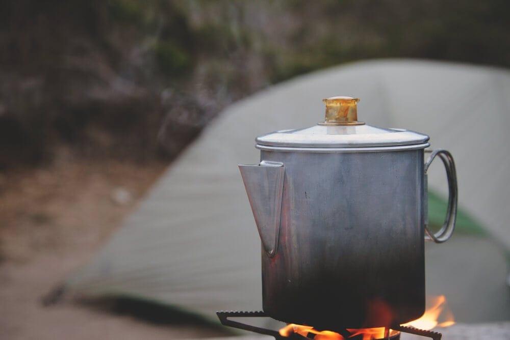 Steel-percolator-heating-up-on-camping-burner