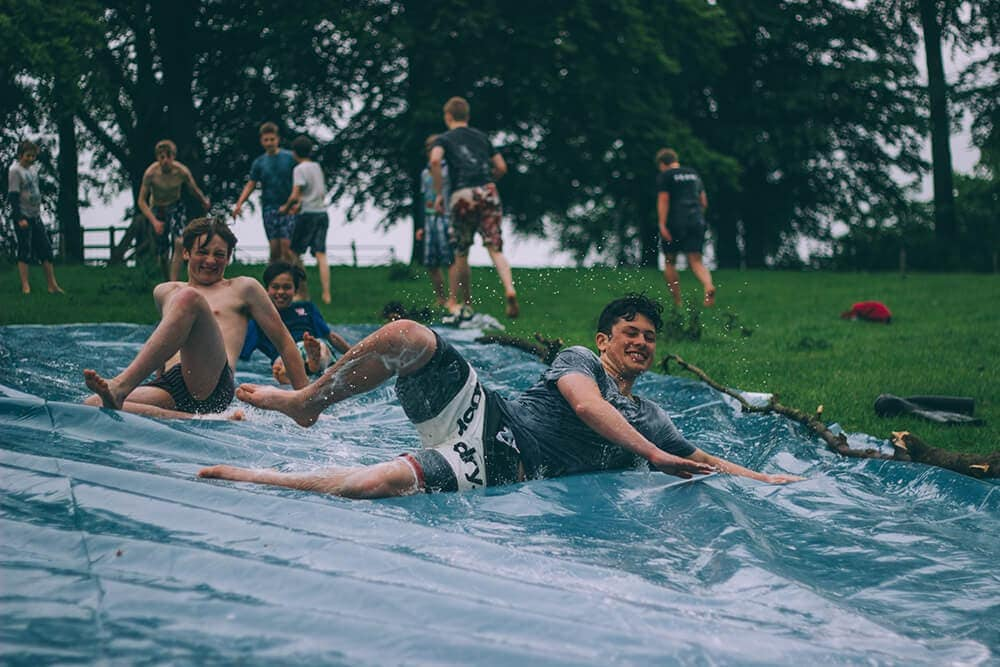 Tarp used as slippy slide