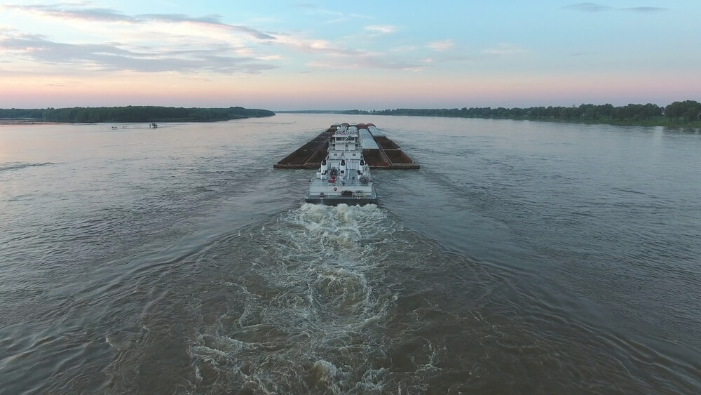 Tow boat at dusk on mississippi river