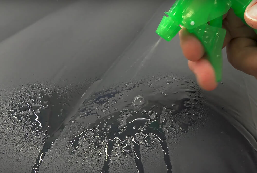 Applying or spraying soapy water is a common way to find holes in air mattress