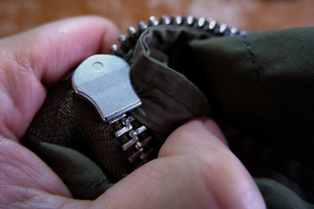 Zipper stuck on green olive jacket